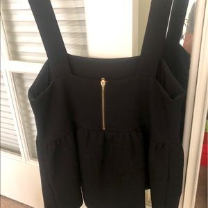 Black peplum top. New without tags.